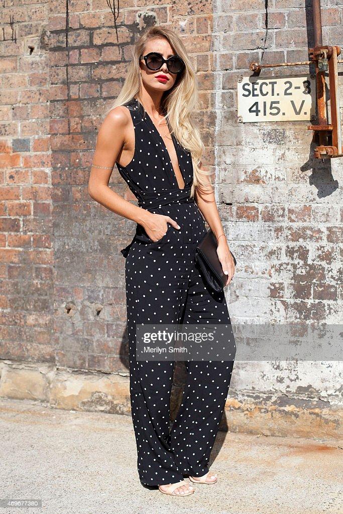 Fashion Blogger Tatjana Catic wears a Bec and Bridge jumpsuit Valentino sunglasses Zara bag and Nine West shoes at MercedesBenz Fashion Week...