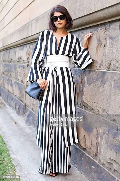 Fashion Blogger Telisha Sudon wears a Lee Mathews coat and trousers Triwa sunglasses Celine bag and Aquazzura shoes at MercedesBenz Fashion Week...
