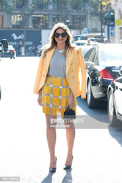 Fashion Blogger Thassia Naves wears a Balmain jacket Marco de Vincenzo skirt Topshop top Luiza Barcelos shoes Saint Laurent bag and Celine sunglasses...