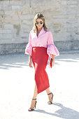 Fashion Blogger Thassia Naves wears a Carven skirt Dior shirt Urania Gazelli bag Miu Miu shoes and Rayban sunglasses on day 5 during Paris Fashion...