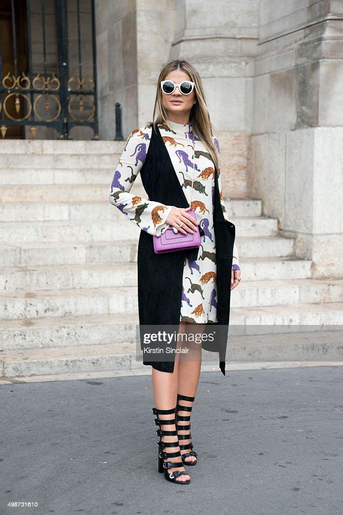 Fashion Blogger Thassia Naves wears a Stella McCartney dress Tale sleeveless top Aquazzura shoes Bulgari bag and Illesteva sunglasses on day 7 during...