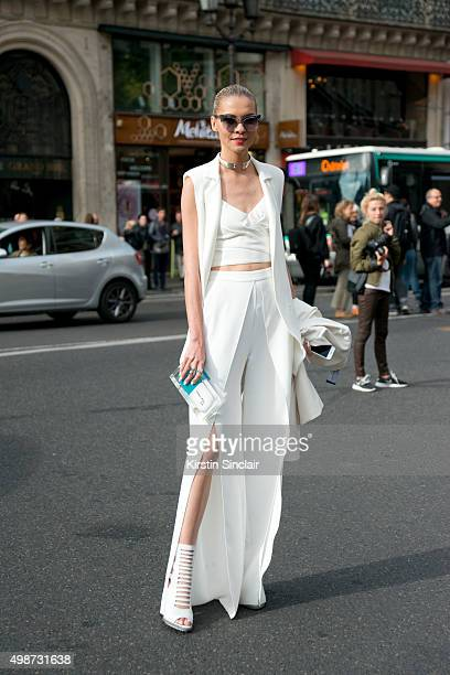 Fashion Blogger Thassia Naves wears a Stella McCartney dress Tale sleeveless top Aquazzura shoes Bulgari bag and Illesteva sunglasses on day 7 during...