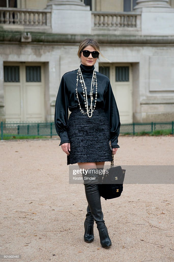 Fashion Blogger Thassia Naves wears Casadei boots Karen Walker sunglasses Chanel bag and necklace skirt and shirt on day 8 during Paris Fashion Week...
