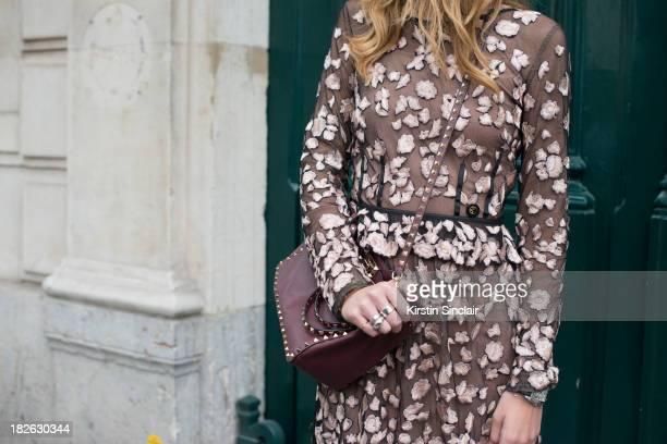 Fashion blogger 'The Blonde Salad' Kiara Ferrangi wears Roberto Cavalli dress and a Valentino bag on day 6 of Paris Fashion Week Spring/Summer 2014...