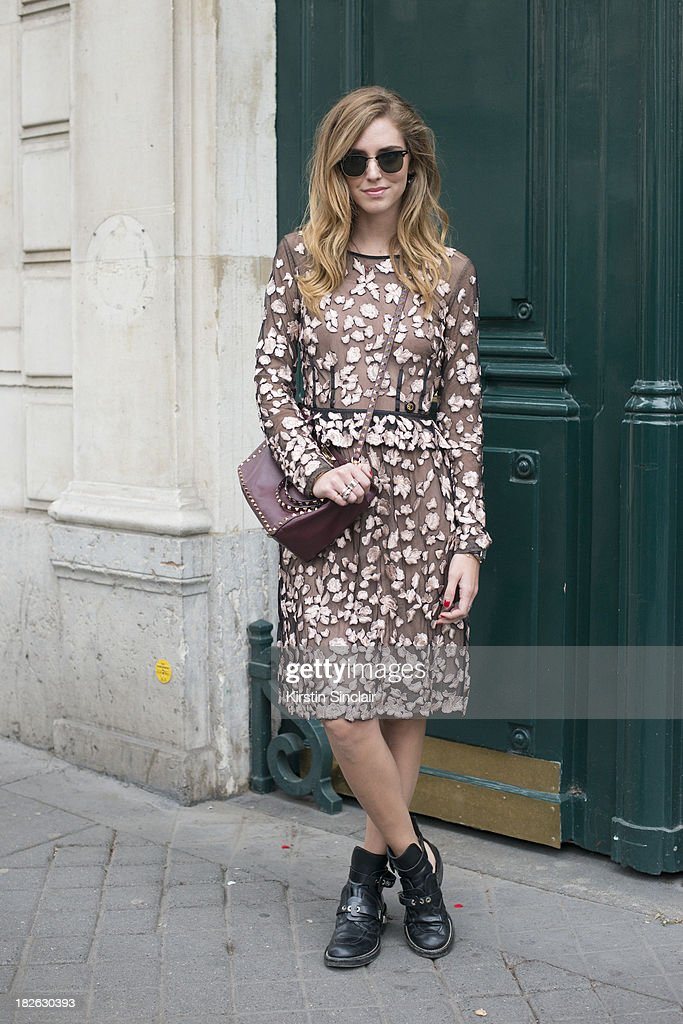 Fashion blogger 'The Blonde Salad' Kiara Ferrangi wears Roberto Cavalli dress, Balenciaga boots, Ray Ban sunglasses and a Valentino bag on day 6 of Paris Fashion Week Spring/Summer 2014, Paris September 29, 2013 in Paris, France.