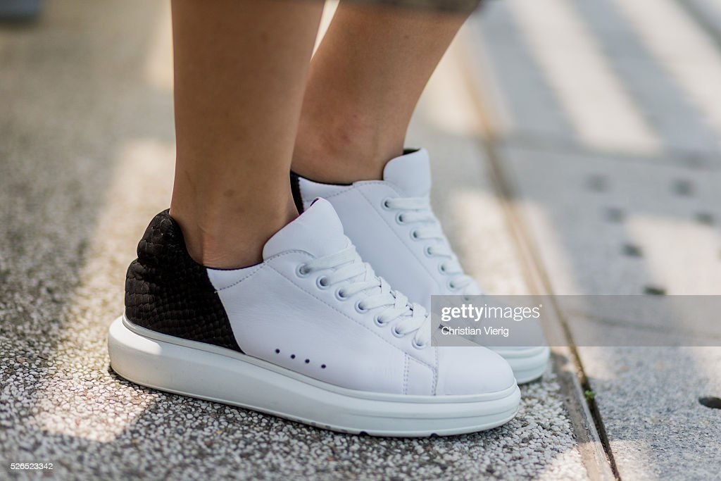 Fashion blogger Theresa Twee Wu wearing white Pedder Red sneakers on April 30, 2016 in Hong Kong, Hong Kong.