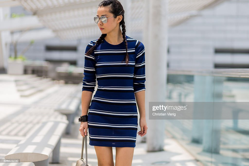 Fashion blogger Theresa Twee Wu with braids wearing a navy black white striped H&M dress, a Gucci Dionysus shoulder bag on April 30, 2016 in Hong Kong, Hong Kong.