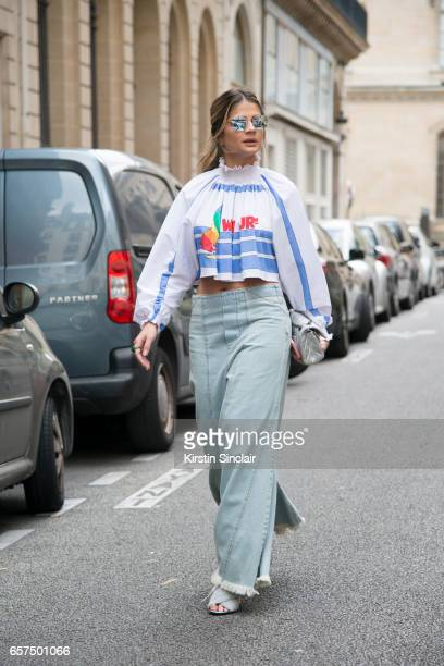 Fashion blogger Thássia Naves wears a Juliana Jabour top Chloe jeans Gucci shoes Chanel bag and Ray Ban sunglasses day 2 of Paris Haute Couture...