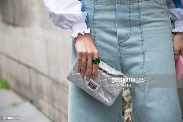 Fashion blogger Thássia Naves wears Chloe jeans and a Chanel bag day 2 of Paris Haute Couture Fashion Week Autumn/Winter 2016 on July 4 2016 in Paris...