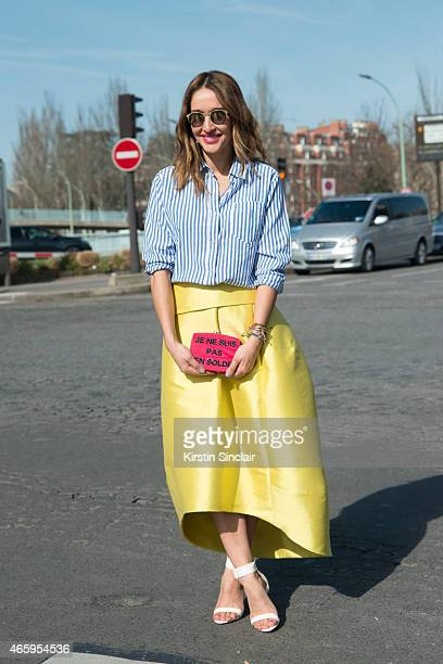 Fashion blogger Tiany Kiriloff wears Isabel Marant shirt Kyme sunglasses Natan skirt Aperlai shoes and Chanel bag on day 6 of Paris Collections Women...