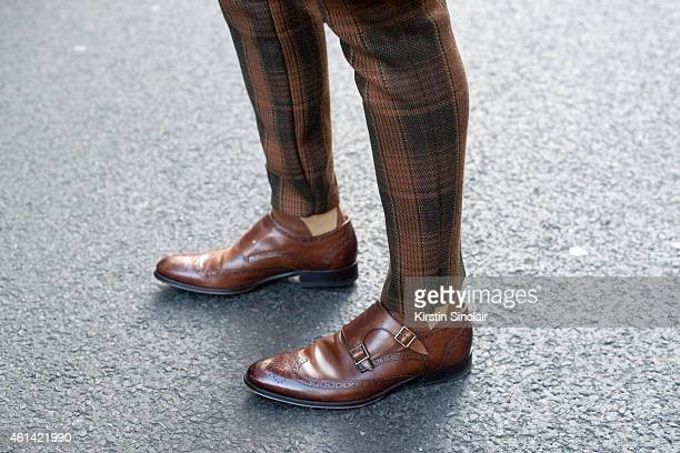 Fashion blogger Toni Tran wearing Russell and Bromley shoes Rokit vintage trousers on day 3 of London Collections Men on January 11 2015 in London...