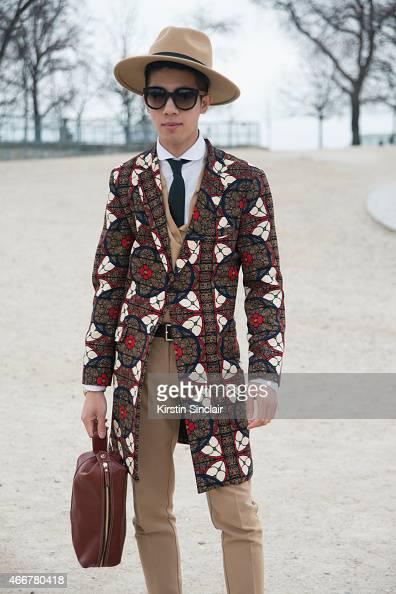 Fashion blogger Toni Tran wears Fashitects collection Bespoke jacket Zara trousers miss Selfridges hat Marc Jacobs sunglasses TM Lewin shirt and...