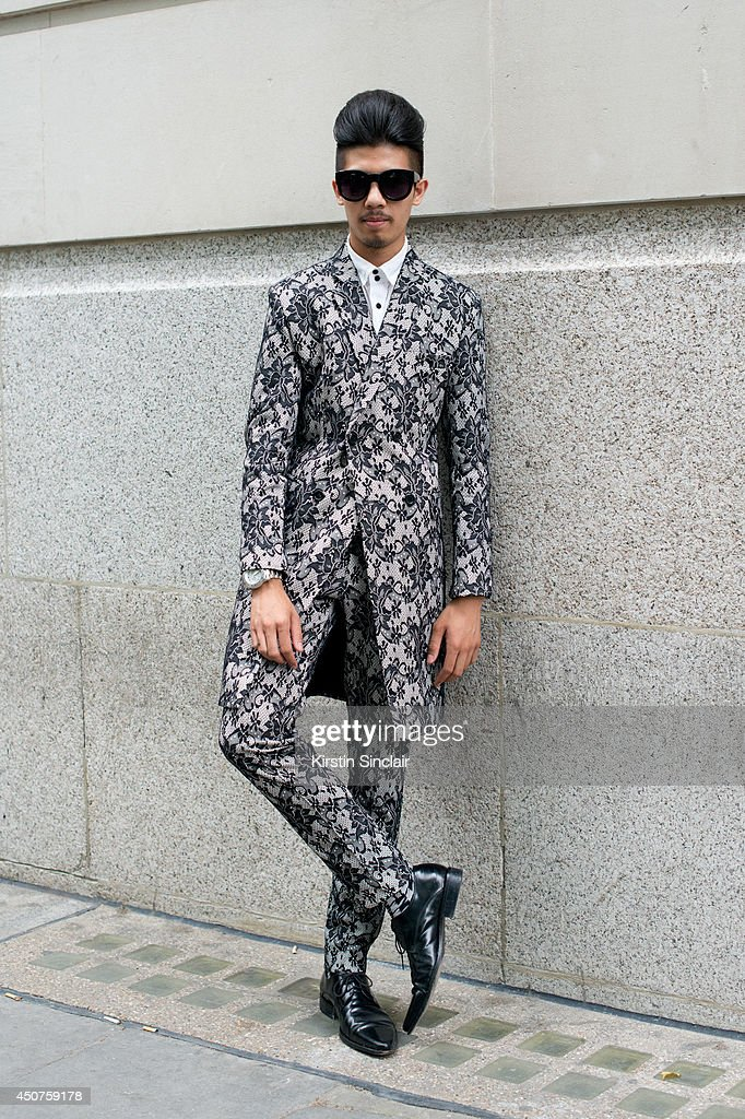 Fashion Blogger Toni Tran wears his own design Bespoke suit Dolce and Gabbana shirt and shoes Acne sunglasses on day 1 of London Collections Men on...