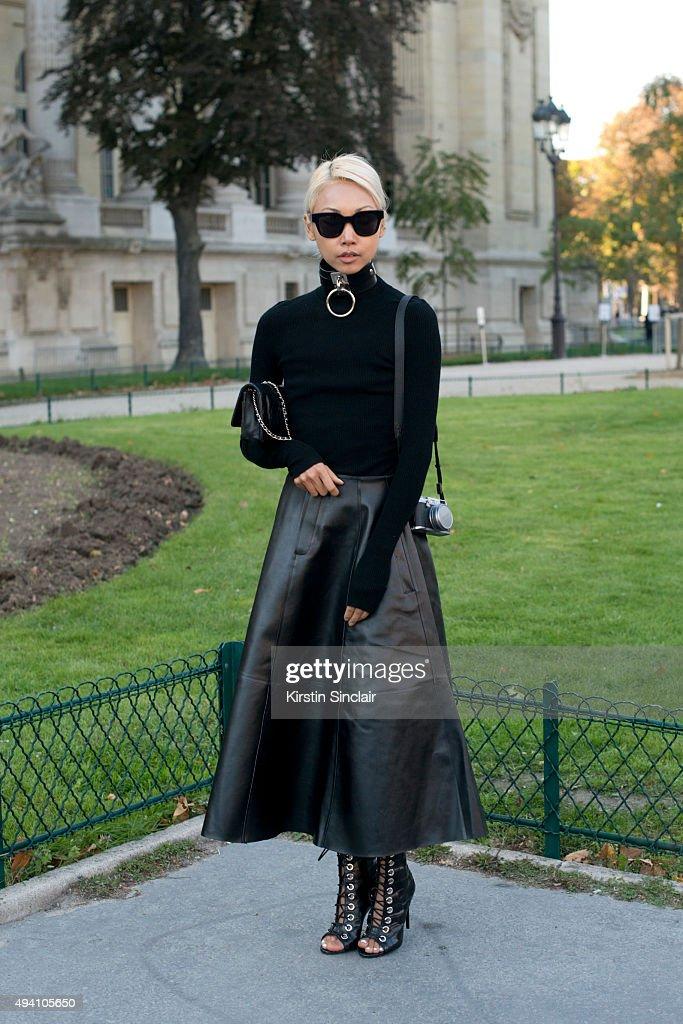 Fashion Blogger Vanessa Hong wears a Chanel bag J H Zane skirt Barbara Bui top and a Zana Bayne chocker on day 3 during Paris Fashion Week...