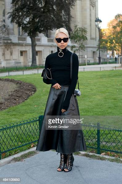 Fashion Blogger Vanessa Hong wears a Chanel bag J H Zane skirt Barbara Bui top and a Zana Bayne chocker on day 3 during Paris Fashion Week...