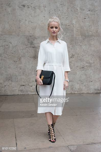 Fashion blogger Victoria Magrath wears a Joseph dress Balmain for H and M shoes and a Celine bag on day 4 of Paris Haute Couture Fashion Week...