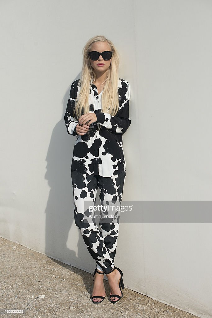 Fashion blogger Victoria Tornegren wearing a Top Shop top and trousers, Asos shoes and Le Specs sunglasses on day 9 of Paris Fashion Week Spring/Summer 2014, Paris October 02, 2013 in Paris, France.