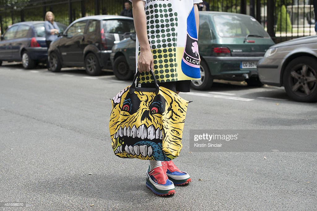 Fashion blogger Weichen Gao wearing a Raf Simons top and trainers and a Jeremy Scott bag on day 1 of Paris Collections: Men on June 25, 2014 in Paris, France.