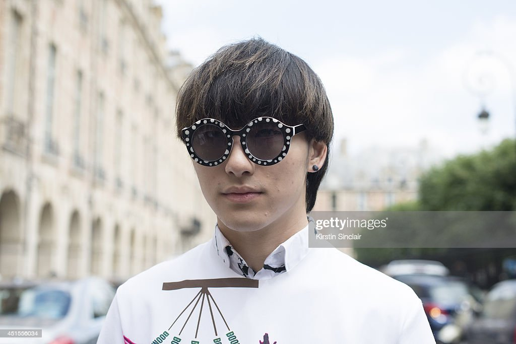 Fashion blogger Weichen Gao wearing a Raf Simons top, Jeremy Scott sunglasses from a market in Korea on day 1 of Paris Collections: Men on June 25, 2014 in Paris, France.