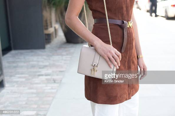 Fashion Blogger Wendy Gilmour wears an Iris and Ink at The Outnet dress H and M jeans Maison Scotch belt and Reiss bag on day 3 during London Fashion...