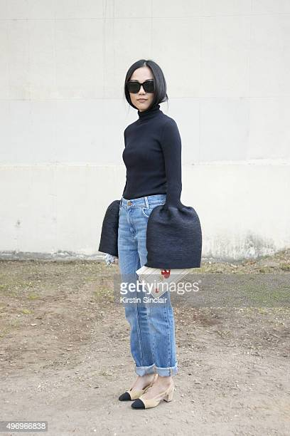Fashion Blogger Yoyo wears a Celine top and sunglasses and Chanel shoes on day 6 during Paris Fashion Week Spring/Summer 2016/17 on October 4 2015 in...