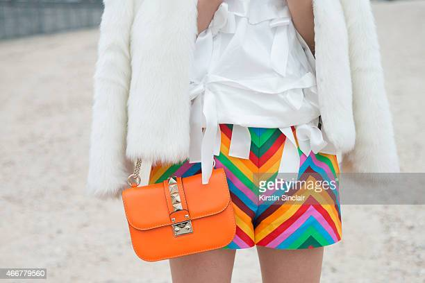 Fashion blogger Yu Yu wears a vintage jacket Valentino shorts and bag Nicole Panda top on day 8 of Paris Collections Women on March 10 2015 in Paris...