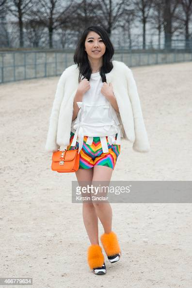 Fashion blogger Yu Yu wears a vintage jacket Valentino shorts and bag Nicole Panda top and Pierre Hardy trainers on day 8 of Paris Collections Women...