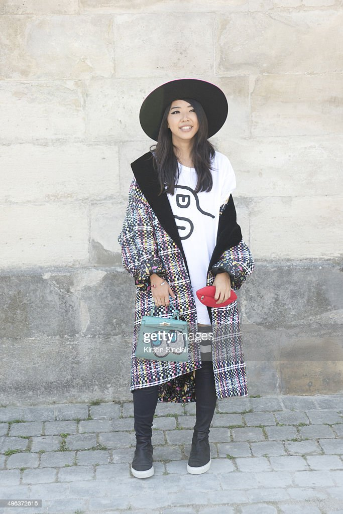 Fashion Blogger Yuwei Zhangzou Yuyu wears a Mini Me Paris jacket and hat Eugene Riconneaus shoes and a Play No More bag on day 5 during Paris Fashion...