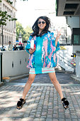 Fashion Blogger Yuyu wears a Roberta Eina dress Pierre Hardy shoes Dior sunglasses and Preciously bag on day 3 during London Fashion Week...