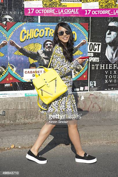 Fashion Blogger Yuyu wears all Kenzo and Dior sunglasses on day 6 during Paris Fashion Week Spring/Summer 2016/17 on October 4 2015 in Paris France