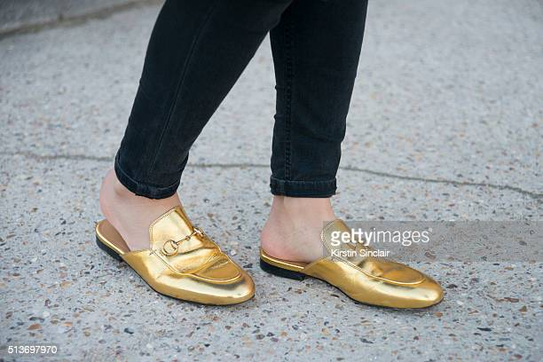 Fashion blogger Yuyu wears Gucci shoes and Hakaan jeans on day 3 during Paris Fashion Week Autumn/Winter 2016/17 on March 3 2016 in Paris France