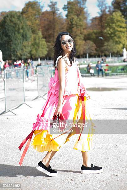 Fashion Blogger YuYu Yuwei Zhangzou wears an Anna K Kenzo shoes Rocio bag and Dior sunglasses on day 8 during Paris Fashion Week Spring/Summer...