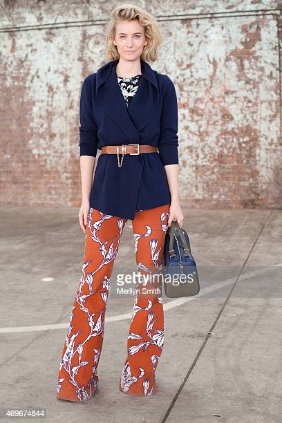 Fashion Blogger Zanita wears a Tome shirt Oroton cardigan Karen Walker belt and trousers and a Benah for Karen Walker bag at MercedesBenz Fashion...