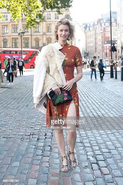 Fashion Blogger Zanita Whittington wears a Tibi jacket Topshop dress Marni shoes and Christoper Kane bag on day 3 during London Fashion Week...