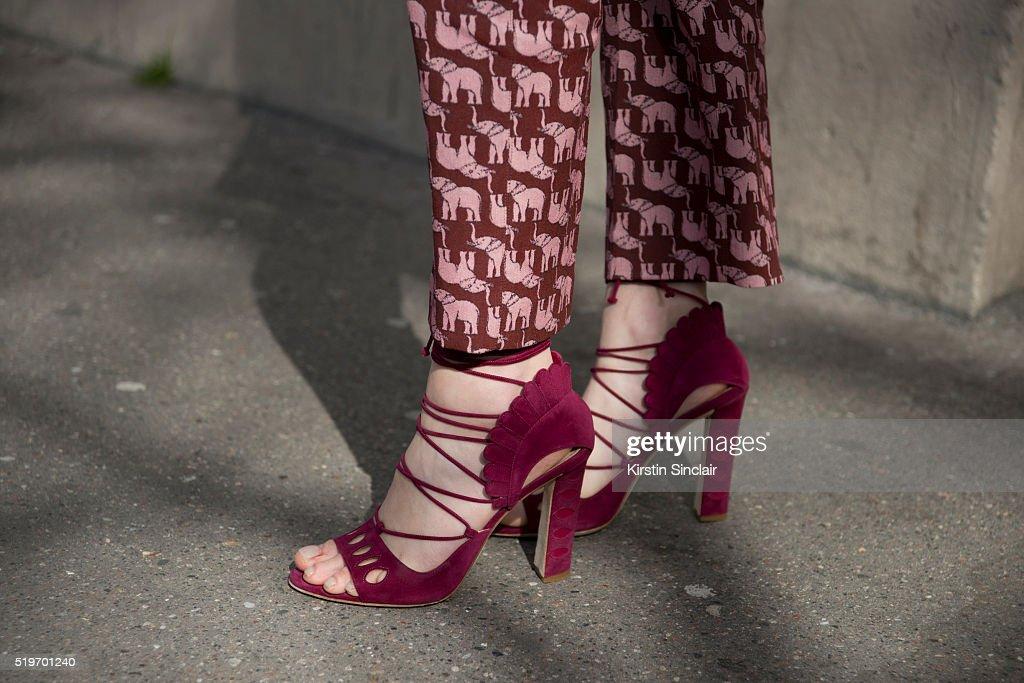 Fashion Blogger Zina Charkoplia wears a Pinko suit and Paula Cademartori shoes on day 6 during Paris Fashion Week Autumn/Winter 2016/17 on March 6...