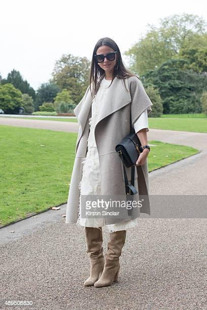 Fashion blogger Zina Charkoplia wears all Tibi Gianvito Rossi boots Celine sunglasses Yves Saint Laurent bag on day 4 during London Fashion Week...