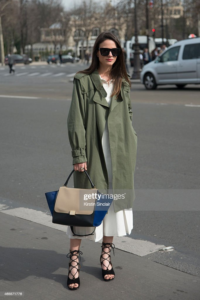 Fashion blogger Zina Charkoplia wears an H and M top Chloe shoes Zara coat Celine bag Reiss skirt and ASOS sunglasses on day 5 of Paris Collections...
