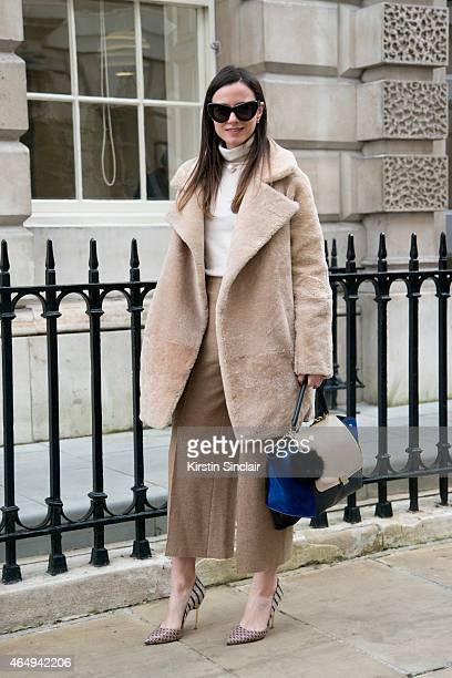 Fashion blogger Zina Charkoplia wears Celine bag and sunglasses Zara top and trousers Kurt Geiger shoes and a H and M necklace on February 24 2015 in...