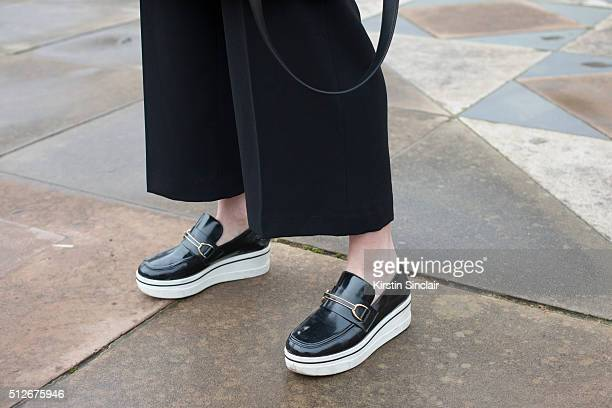 Fashion blogger Zina Charkoplia wears Topshop trousers and Stella McCartney shoes on day 4 during London Fashion Week Autumn/Winter 2016/17 on...