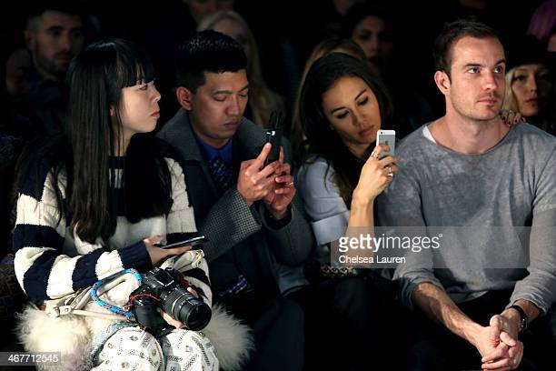 Fashion Bloggers Susie Bubble Brianboy and Rumi Neely attend the Helmut Lang fashion show during MercedesBenz Fashion Week Fall 2014 on February 7...