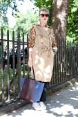 Fashion Buyer Alice Feillard wears a Lahssan trench coat Celine bag and sunglasses Cedric Charlier jeans and Acne shoes on day 3 of London...