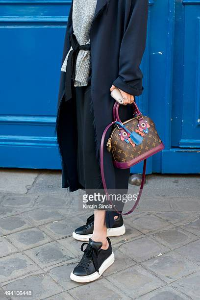 Fashion Buyer and Actress Guo Xiayan wears a Louis Vuitton bag Cos jacket Zara sweater McQueen shoes and a Zara skirt on day 3 during Paris Fashion...