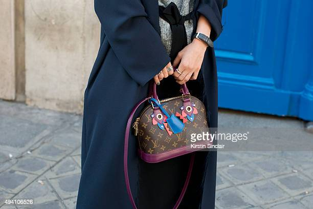 Fashion Buyer and Actress Guo Xiayan wears a Louis Vuitton bag Cos jacket Zara sweater and a Zara skirt on day 3 during Paris Fashion Week...