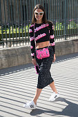 Fashion Buyer and Blogger Zina Charkoplia is wearing a Moschino iPhone case Proenza Schouler bag top and skirt Adidas trainers and Marc Jacobs...