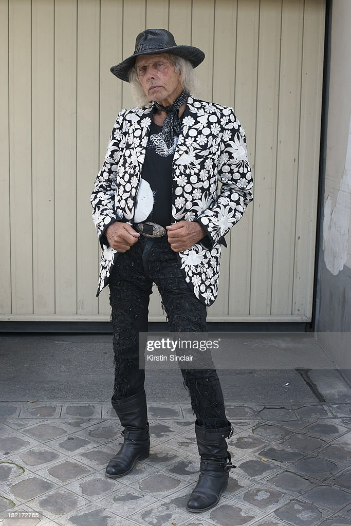 Fashion buyer and designer <a gi-track='captionPersonalityLinkClicked' href=/galleries/search?phrase=James+Goldstein&family=editorial&specificpeople=712878 ng-click='$event.stopPropagation()'>James Goldstein</a> wears John Galliano trousers, Saint Laurent t shirt, Dolce and Gabbana bag, own design hat and Christian Dior shoes on day 4 of Paris Fashion Week Spring/Summer 2014, Paris September 27, 2013 in Paris, France.