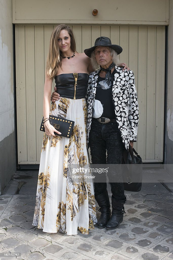 Fashion buyer and designer <a gi-track='captionPersonalityLinkClicked' href=/galleries/search?phrase=James+Goldstein&family=editorial&specificpeople=712878 ng-click='$event.stopPropagation()'>James Goldstein</a> wears John Galliano trousers, Saint Laurent t shirt, Dolce and Gabbana bag, own design hat and Christian Dior shoes and Model Vanja Josic wears all <a gi-track='captionPersonalityLinkClicked' href=/galleries/search?phrase=James+Goldstein&family=editorial&specificpeople=712878 ng-click='$event.stopPropagation()'>James Goldstein</a> on day 4 of Paris Fashion Week Spring/Summer 2014, Paris September 27, 2013 in Paris, France.