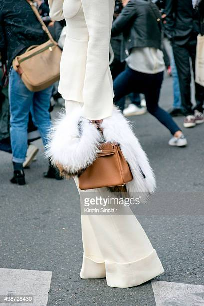 Fashion Buyer and Owner of Kabuki Paris Elina Halimi wears a Maison Michel hat Stella McCartney top and trousers Hermes bag Isabel Marant sunglasses...