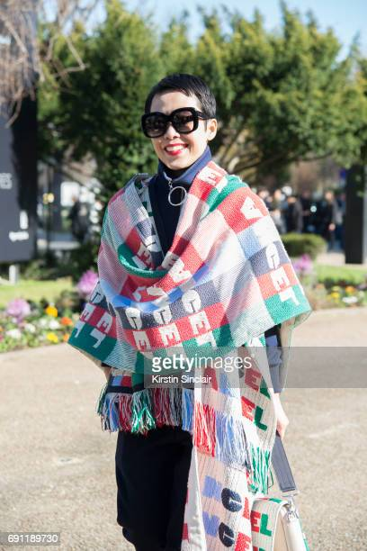 Fashion buyer and stylist Tera Feng wears an Angel Chen poncho and bag on day 3 during Paris Fashion Week Autumn/Winter 2017/18 on March 2 2017 in...