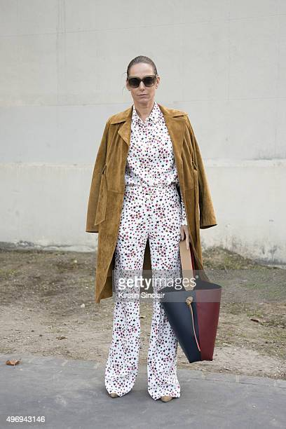 Fashion Buyer Catherine Bruss wears a Celine coat sunglasses and bag and Sonia Rykiel shirt and trousers on day 6 during Paris Fashion Week...