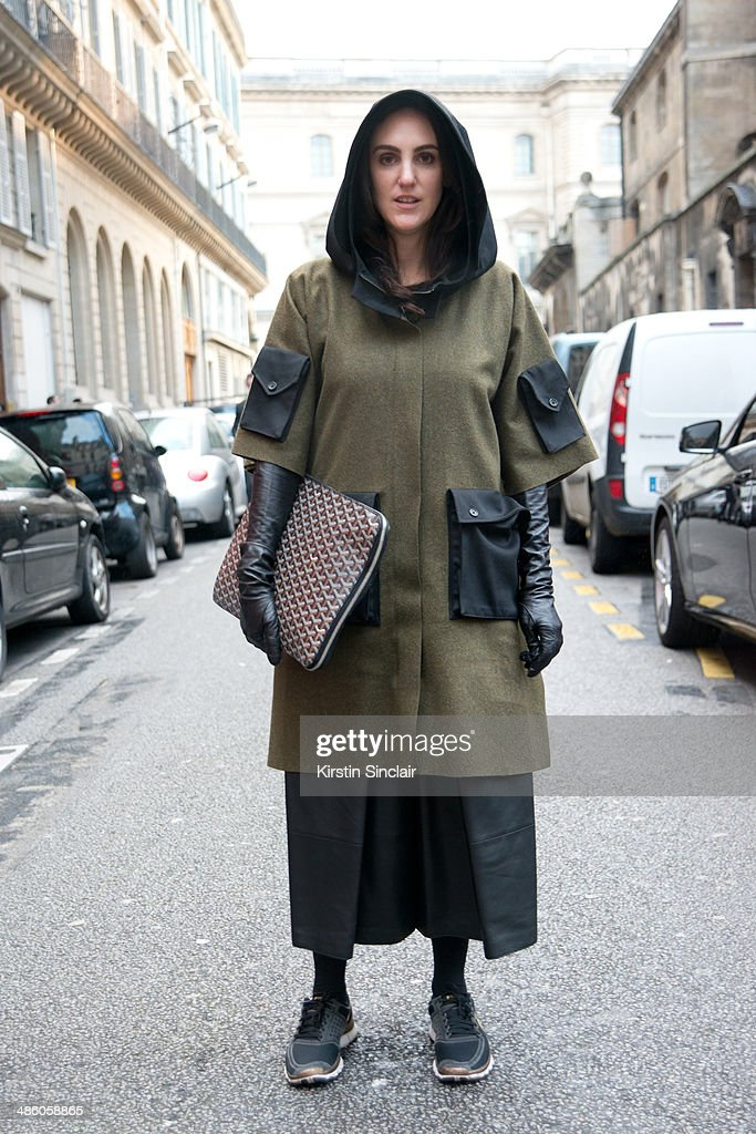 Fashion Buyer Diana Paolucci wears a Yang Li coat Nike trainers and Goyard bag on day 5 of Paris Collections Women on March 01 2014 in Paris France